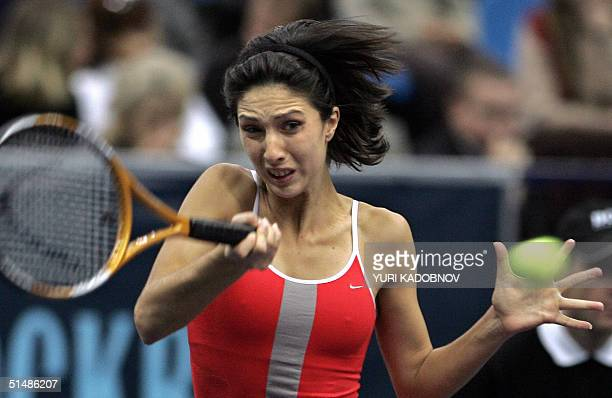 Russian Anastasia Myskina hits the ball to US Lindsay Davenport during the semifinal match at the WTA Kremlin Cup tennis tournament in Moscow 16...