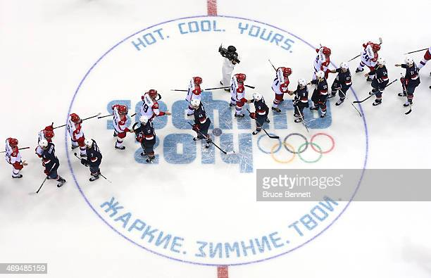 Russian and American players shake hands after the United States won 32 against Russia during the Men's Ice Hockey Preliminary Round Group A game on...