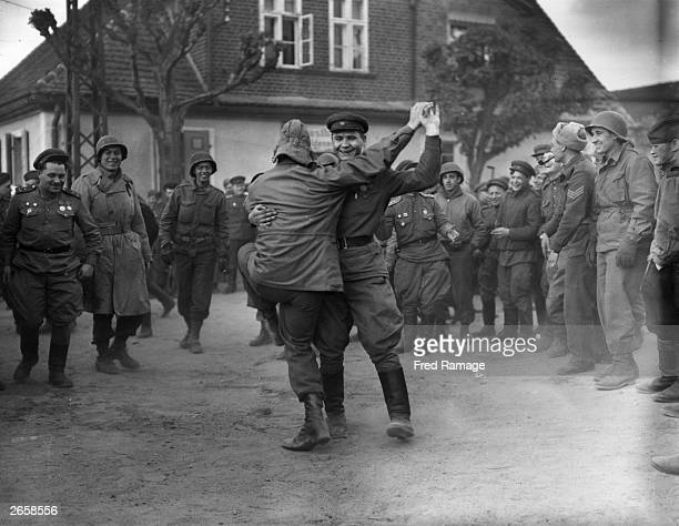 Russian and American troops dancing together when the official linkup was made between the US 9th Army and the Russians at Cobblesdorf