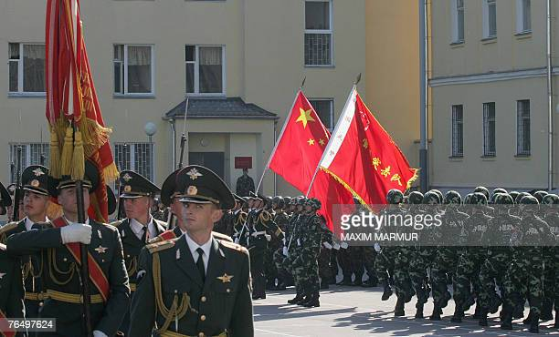 Russian and Chinese soldiers march during the opening ceremony of the RussianChinese joint counterterrorism exercise called 'Friendship 2007' in...