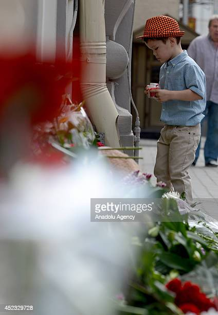 Russian and Dutch citizens light candles and lay flowers in front of the Embassy of the Netherlands for passengers died in the crash of Malaysia...
