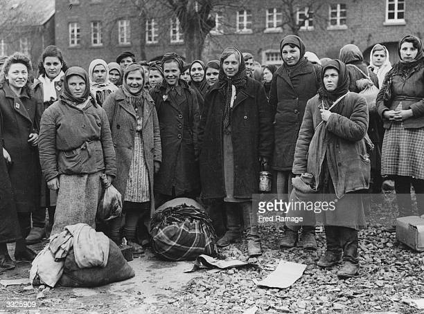 Russian and Polish girls who were used as slave workers in Germany join refugees in Julich after liberation by the US 9th Army