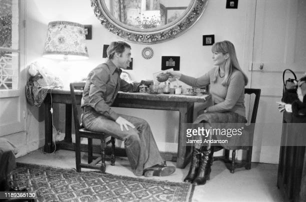 Russian antiestablishment actor poet songwriter and singer Vladimir Vysotsky at the home with his wife French actress Marinal Vlady who has prepared...
