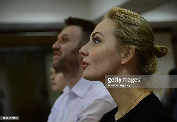 Russian antiKremlin opposition leader Alexei Navalny accompanied his wife Yulia Navalny attend the action of objection verdict announcement of their...