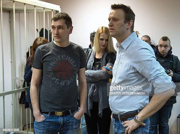 Russian antiKremlin opposition leader Alexei Navalny and his brother and codefendant Oleg attend the verdict announcement of their fraud trial at a...