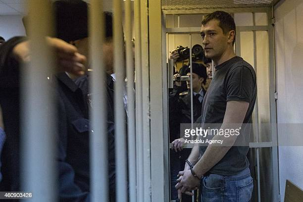 Russian antiKremlin opposition leader Alexei Navalny and his brother Oleg Navalny attend the verdict announcement of their fraud trial at a court in...