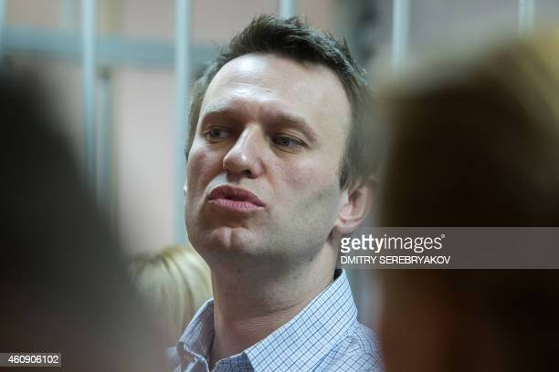 Russian antiKremlin opposition leader Alexei Navalny speaks as he attends the verdict announcement of his fraud trial at a court in Moscow on...