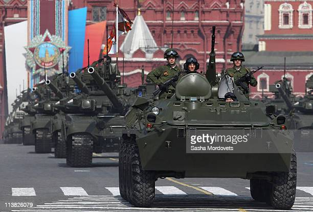 Russian APC and tanks manoeuvre during May Day parade rehearsals in front of StBasil's cathedral at Red Square May 7 2011 in Moscow Russia Russia...