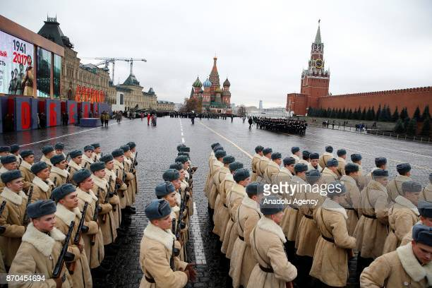 Russian Army members dressed in historical uniforms take part in a rehearsal for a military parade to mark the anniversary of a historical parade in...