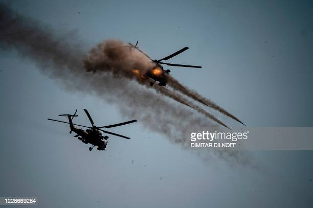 Russian army Mi-28 helicopter launches rockets during military exercises at the Raevsky range in Southern Russia on September 23, 2020 during the...