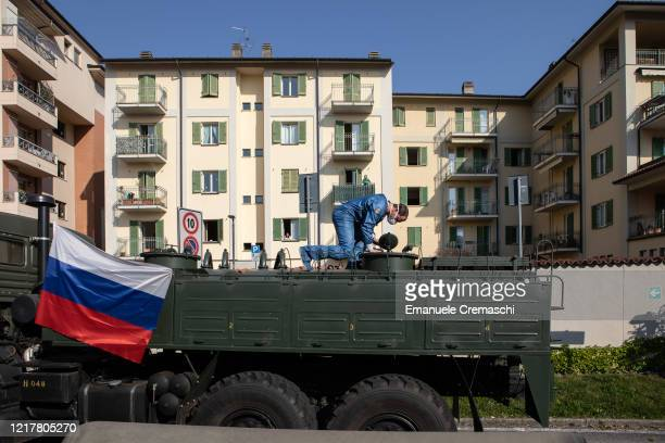 Russian Army officer controls a manhole over a truck at Istituto Palazzolo nursing home on April 09, 2020 in Torre Boldone, Italy. According to...