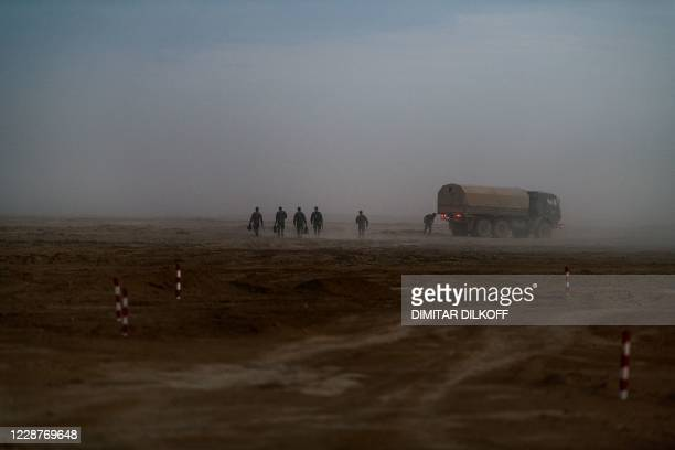 Russian Army officers walk through dusty field after the end of military exercises at the Kapustin Yar range in Astrakhan region, Southern Russia on...