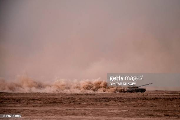 Russian Army T-72-B3 main battle tank moves through the dust during military exercises at the Kapustin Yar range in Astrakhan region, Southern Russia...