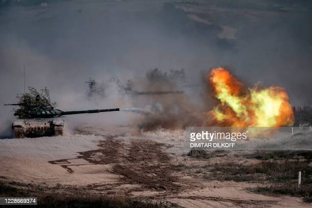 """Russian army T-72-B3 tank fires during military exercises at the Raevsky range in Southern Russia on September 23, 2020 during the """"Caucasus-2020""""..."""