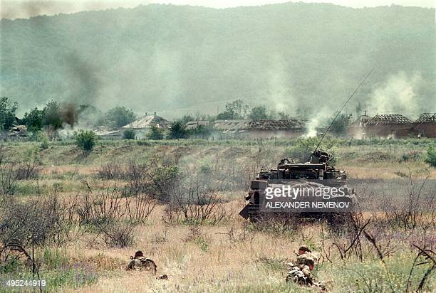 A Russian Army tank followed by commandos enters in the Chechen stronghold of Bamut in May 1996 a village in western Chehnya during the battle...