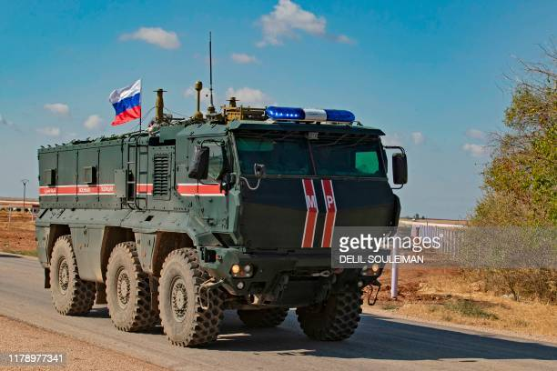 A Russian army vehicle takes part in a patrol of members of the Syrian Kurdish Asayish internal security forces and Russian military police in the...