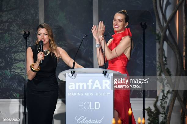Russian art dealer Sandra Nedvetskaia and Czech model Petra Nemcova conduct an auction on May 17 2018 during the amfAR 25th Annual Cinema Against...