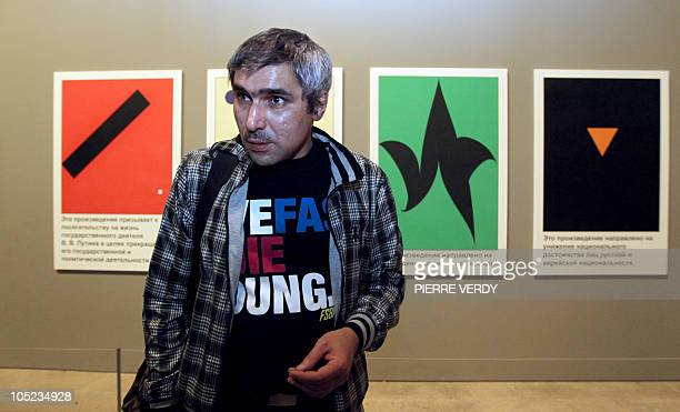 Russian artist Avdei TerOganian poses next to his paintings on October 13 2010 at the Louvre Museum during the exhibition Counterpoint Russian...