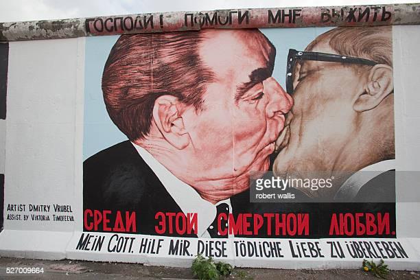 Russian artist Dmitry Vrubel famous Berlin Wall painting of Leonid Brezhnev kissing East German leader Erich Honecker