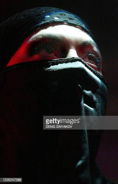 """Russian artist known as NATO perform during a controversial """"kamikaze"""" first night concert in a Moscow 'Tinkoff' club, early 14 January 2005. The..."""