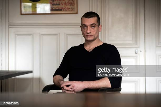 Russian artist Pyotr Pavlensky poses during a press interview with AFP at his lawyer's office in Paris on February 14 2020 Pavlensky was placed in...