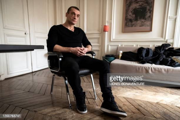 Russian artist Pyotr Pavlensky poses during a press interview with AFP at his lawyer's office in Paris on February 14 2020 Emmanuel Macron's...