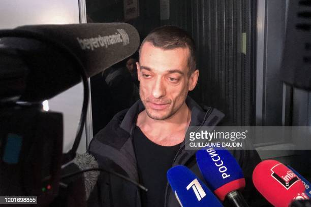 Russian artist Pyotr Pavlensky speaks to the press as he leaves the courthouse of Paris on February 18 after being charged for his role in the...