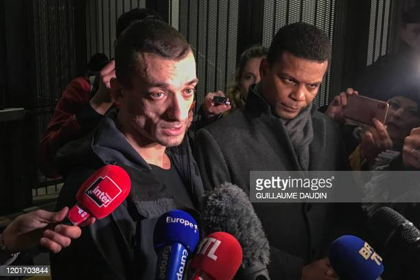 TOPSHOT Russian artist Pyotr Pavlensky speaks to the press flanked by his lawyer Yassine Bouzrou as he leaves the courthouse of Paris on February 18...