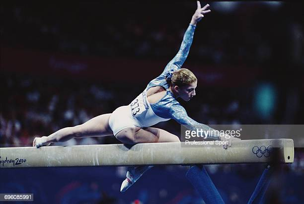 Russian artistic gymnast Yelena Produnova pictured in action competing for Russia on the balance beam during competition in the Women's artistic team...