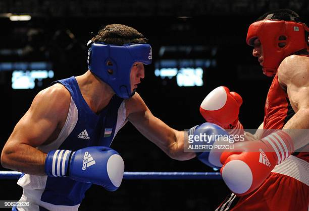 Russian Artur Beterbiev and Uzbekistan Elshod Rasulov box during their Light Heavy 81 kg final of the AIBA World Boxing Cup at Assago Forum in Milan...
