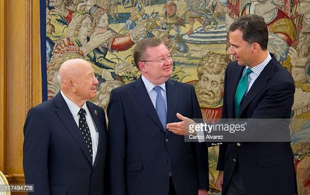 Russian astronaut Alexei Leonov Russian ambassador in Madrid Alexander Kuznetsov and Prince Felipe of Spain pose for the photographers at Zarzuela...