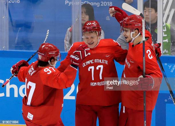 Russian athlete Kirill Kaprizov celebrates with Nikita Gusev and Artyom Zub after scoring a goal during the third period of the preliminary round of...