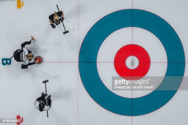 TOPSHOT Russian athletes compete during the curling women's round robin session with between the Olympic Athletes from Russia and Britain during the...