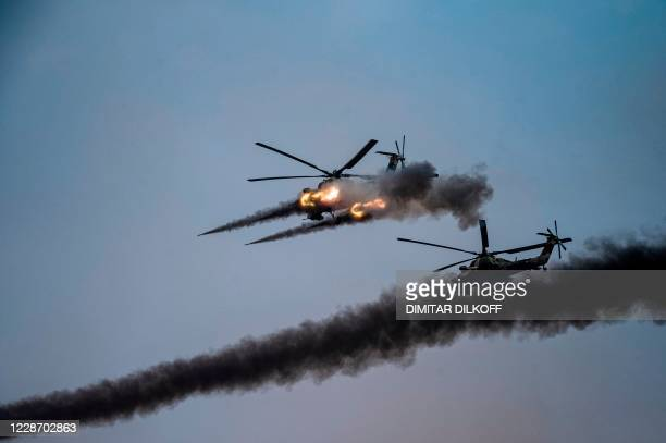 Russian attack helicopters launch rockets during military exercises at the Kapustin Yar range in Astrakhan region, Southern Russia on September 25,...