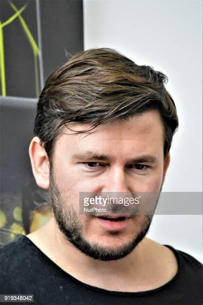 Russian author Dmitry Glukhovsky looks on as he attends 12th International Ankara Book Fair in Ankara Turkey on February 17 2018