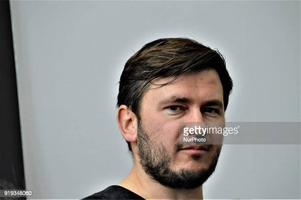 Russian author Dmitry Glukhovsky poses for a photo as he attends 12th International Ankara Book Fair in Ankara Turkey on February 17 2018