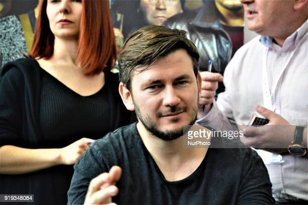 Russian author Dmitry Glukhovsky poses for a photo as he attends 12th International Ankara Book Fair in Ankara Turkey on February 17 2018