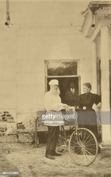 Russian author Leo Tolstoy with a bicycle, Russia, 1890s. Tolstoy is pictured with his wife, Sophia Tolstaya , who he married in 1862. Found in the...