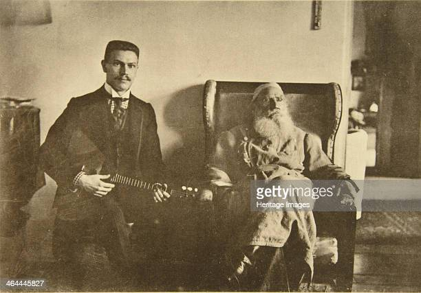Russian author Leo Tolstoy with the balalaika player Boris Troyanovsky Russia 1909 Found in the collection of the State Museum of Tolstoy's Estate at...