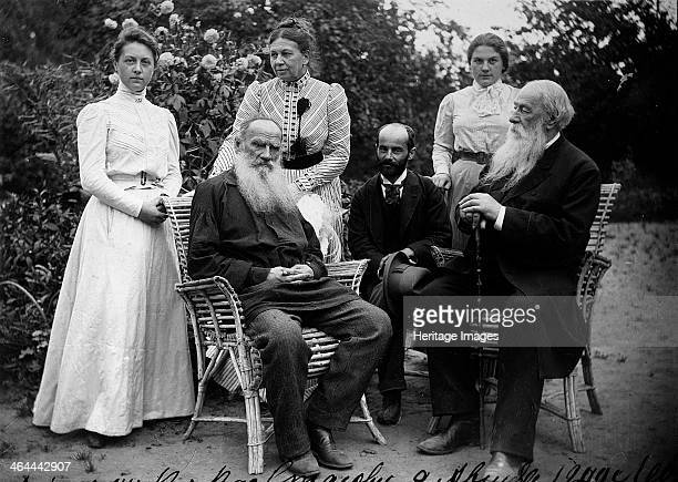 Russian author Leo Tolstoy with visitors, Yasnaya Polyana, Russia, late 19th or early 20th century. Tolstoy is widely regarded as one of the greatest...