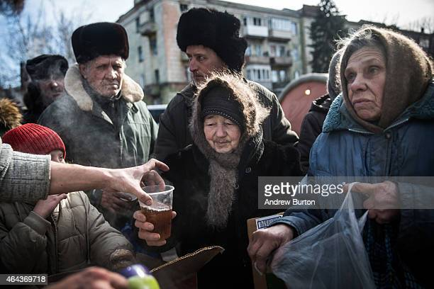 Russian backed rebels serve hot tea to civilians on February 25, 2015 in Debaltseve, Ukraine. After approximately one month of fighting, Russian...