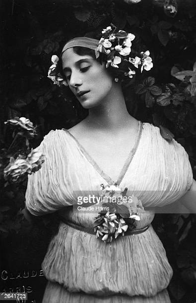 Russian ballerina Anna Pavlova adorned with flowers in a peaceful pose