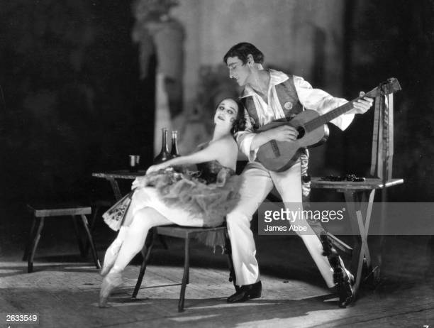 Russian ballerina Anna Pavlova performing on stage with a fellow dancer