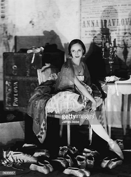 Russian ballerina Anna Pavlova surrounded by her ballet shoes in her dressing room at the Theatre des Champs Elysees in Paris