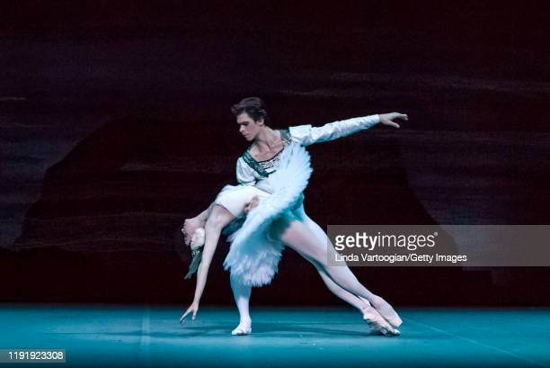 Russian ballet dancers Anna Nikulina and Artem Ovcharenko perform in the Bolshoi Ballet production of 'Swan Lake' during the Lincoln Center Festival...