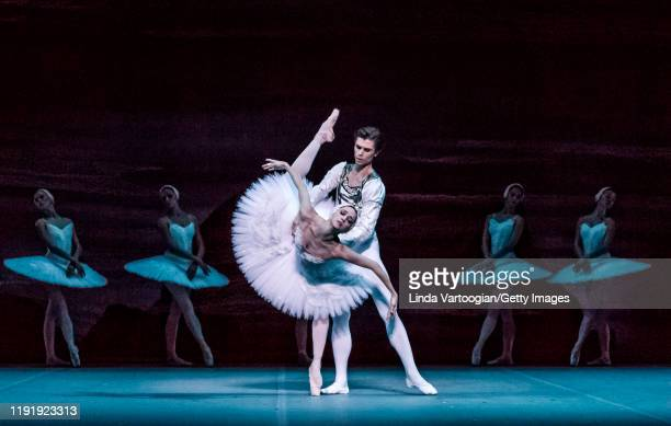 Russian ballet dancers Anna Nikulina and Artem Ovcharenko perform, with the company, in the Bolshoi Ballet production of 'Swan Lake' during the...