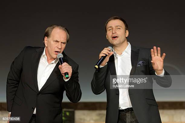 Russian baritone Vladislav Kosarev and actor Aleksei Guskov perform on stage during Russian Film Festival on November 25 2016 in Honfleur France