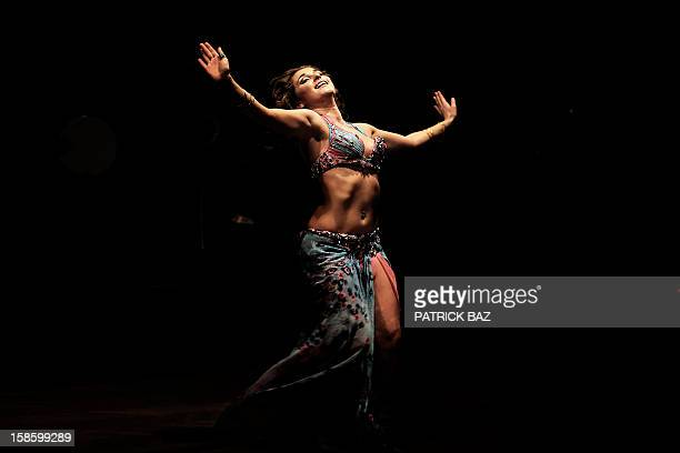 A Russian belly dancer performs in the Egyptian capital Cairo on December 12 2012 This picture was taken during a belly dancing festival with...