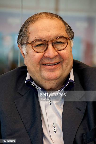 Russian billionaire Alisher Usmanov smiles during a Bloomberg interview in Moscow Russia on Thursday April 25 2013 Usmanov Russia's wealthiest man...