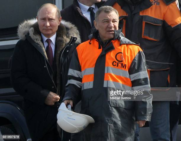 Russian billionaire and businessman Arkady Rotenberg looks on during a visit with Russian President Vladimir Putin to the construction site for the...